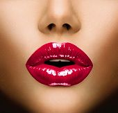 Sexy Lips. Beauty Red Lip Makeup Detail. Beautiful Make-up Closeup. Sensual Open Mouth. lipstick or