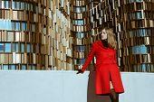 Beautiful Girl Posing With Red Coat