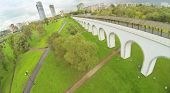 Green park with aqueduct in city. View from unmanned quadrocopter.