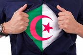Young Sport Fan Opening His Shirt And Showing The Flag His Country Algeria, Algerian Flag