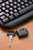 image of car key  - The black computer keyboard and key from car - JPG