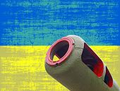 War In Ukraine.artillery Cannon Against Of Destroyed Ukrainian Flag.
