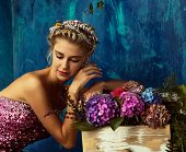 Beautiful blond woman with braid hairstyle and natural makeup. Wearing ping bohemian sequin and feat