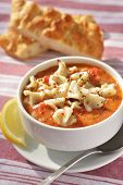 Tomato soup with manti and pide bread. Selective focus