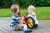 Funny Little Sibling  Boys Repairing Bicycle Wheel