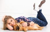 Cute, attractive girl with fluffy dog