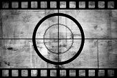 image of countdown  - Vintage movie film strip with countdown border over grunge background - JPG
