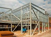 foto of skeleton  - The skeleton frame of a Steel framed building showing the vertical steel columns and horizontal I beams on a new Commercial property Office development - JPG