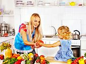 Mother  feed happy child at kitchen .