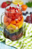 stock photo of sangria  - Fresh Summer Rainbow Sangria with Colorful Fruits And Berries - JPG