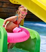Little girl sitting on inflatable ring.
