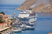 SYMI, GREECE - JUNE 23, 2011: Cyprus based cruise ship Salamis Filoxenia docks at Yialos harbour on