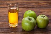 image of cider apples  - Glass of apple juice and green apples on wooden background - JPG