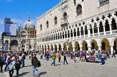VENICE, ITALY - APRIL 12: A crowd in Piazzetta San Marco around the Palazzo Ducale and the Basilica