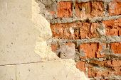 Old Brick Wall With Half White Tiles