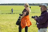 BERLIN, GERMANY - MAY 20, 2014: Unidentified avia-photographers during the International Aerospace Exhibition ILA Berlin Air Show-2014.