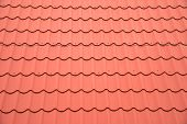 picture of red roof  - Modern red roof of metal closeup - JPG