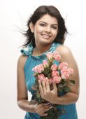 Indian teenage girl with  bunch of pink roses