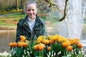 Happy Girl With Yellow Tulips.