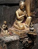 Golden Sculpture Of Praying Man. Nepal Kathmandu
