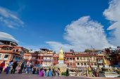 Nepalese people and foreign tourists and pilgrims visiting Buddhist Shrine Boudhanath Stupa. Nepal