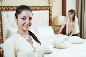 Hotel service. female housekeeping workers at inn room