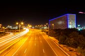 Intensive traffic on highway with blue neon cube