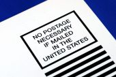 No postage is necessary to mail in the U.S. isolated on blue
