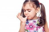image of finger-licking  - young girl on white background licking finger - JPG