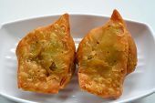 foto of samosa  - Samosa is a popular appetizer or snack dish in India - JPG