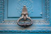 Brass Door Handle On A Colorful Blue Door