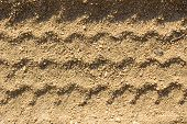Car Tire Tracks On Sand, As Background