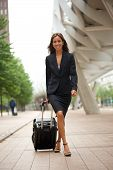 Business Woman Walking In The City With Suitcase