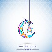 stock photo of eid card  - Colorful moon and star hanging by ribbon on shiny blue background - JPG