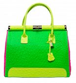 Bright neon green, pink and yellow bag with gold lock and ostrich texture leather isolated on white