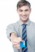 Cheerful Businessman Giving His Credit Card