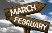 Time concept on wooden sign, March x February