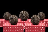 Traditional Brazilian Brigadeiro on black background