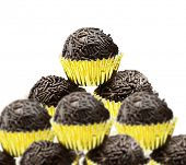 Lots of Brazilian Brigadeiro on white background