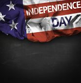 USA Independence Day waving flag on blackboard background