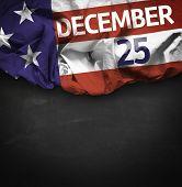 USA December 25, comemorative flag on blackboard background