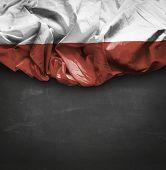 Poland waving flag on blackboard background