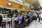 SAO PAULO, BRAZIL - CIRCA SEPTEMBER 2014: People eating at Municipal Market (Mercado Municipal) in Sao Paulo.