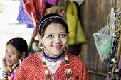 CHIANG MAI, THAILAND - CIRCA MAY 2014: Woman in traditional costumes at Karen Long Neck hill tribe village in Chiang Mai, Thailand.
