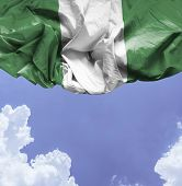 Nigeria waving flag on a beautiful day