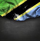 Tanzania waving flag on blackboard