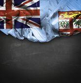 Fiji waving flag on blackboard