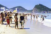 RIO DE JANEIRO, BRAZIL - CIRCA NOV 2013: People enjoying a hot day in Copacabana Beach in Rio de Janeiro, Brazil