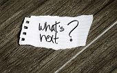 Whats Next notepaper on the wood background