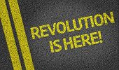 Revolution is Here written on the road